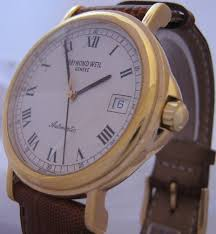 raymond weil tradition gold case white dial leather strap this raymond weil watch comes our own one year warranty and all of our pre owned or other brand watches come our usual 14 day return guarantee