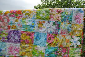 Hideaway Girl: Couple-O-Vintage Sheet Quilts & And, since Cori is expecting her first baby (a girl) in a few months, this  little patchwork vintage sheet baby quilt is for her as well. Adamdwight.com