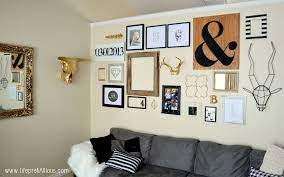 black white and gold gallery wall