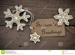 Seasons Greetings On A Label With Ginger Bread Cookies Stock Image