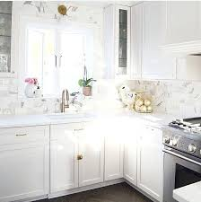 white kitchen cabinets brass hardware marble subway tile quartz counters backsplash with countertops