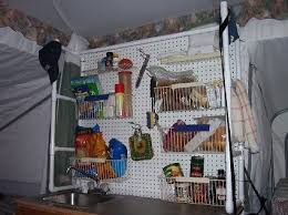 camping organization ideas woh nellie love it kitchen shelves and storage in for a pop up camper use a peg board on a plastic pipe frame cool