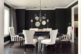 cowhide accent chairs dining room transitional with white chair dark wood floor black table