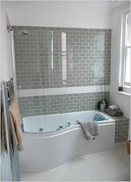 White Subway Tiles Frame A Gray Marble Herringbone Tiled Shower