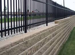 building a fence on top of retaining walls