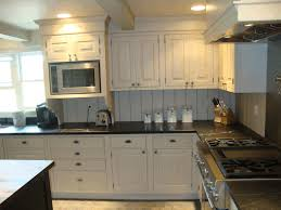 dark gray kitchen cabinets smooth brown granite countertop white wooden counter patterned red carpet black granite smooth countertop