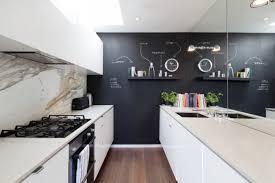 kitchen wall decor ideas black feature wall chalkboard dark wood flooring galley kitchen marble splashback mirror