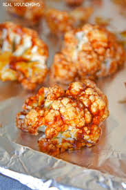 bbq cauliflower bites on a baking sheet ready to be cooked