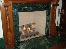 this is a real wood burning fireplace but the cur fuel source is natural gas