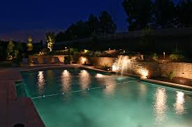 pool deck lighting ideas. outdoor lighting on inground pool waterfall and stone wall multiple low deck ideas