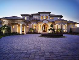 domain homes tampa mediterranean exterior also circular columns covered entry criss crossing curved fence flowers garden grass hardscape hip roof landscape