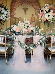 40 elegant ways to decorate your wedding with floral garlands Wedding Decoration Ideas Using Tulle floral wedding chair decor elegant floral garland chair decoration ideas with pink tulle wedding decoration ideas with tulle