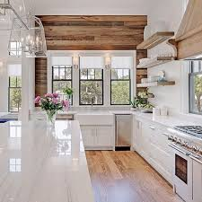 white and wood cabinets. Beautiful Wood Paneling And Floors To Contrast With The White Cabinets Countertops In Kitchen