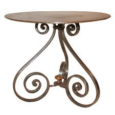 small iron coffee table with 3 scroll