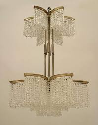 art deco nickel plated double tiered chandelier composed of beaded crystal strands arranged in the