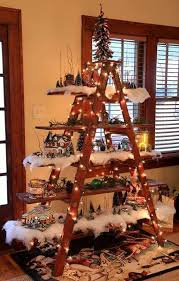 A ladder and a few boards - good way to display Christmas decor