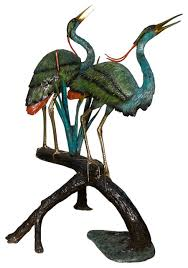 two herons on a branch large bronze