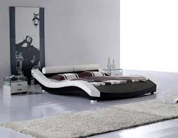 modern canopy bed with light undernearth