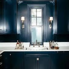 dark blue cabinets with white quartz countertops