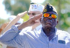 fred williams retired air force of veterans of foreign wars post 2333 salutes during the placing of the wreath at a memorial day ceremony in front of the