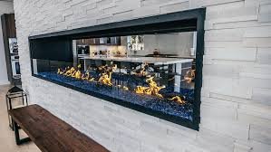 custom gas linear see through open fireplace with half glass