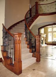 Iron and Wood Stair Railing deck railing ideas at http://awoodrailing.com