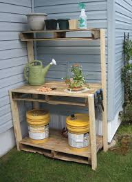 reclaimed wood outdoor potting bench with storage and shelf in the backyard corner house design ideas