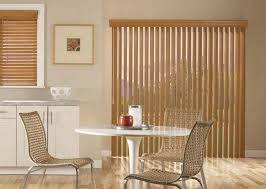 coordinating cloth verticals with wooden valance juxtaposed perfectly with a wood blind in the kitchen window