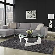 light grey arm square cushion back modular sectional sofa ceramic irreguler clear glass white plywood manufacture coffe table cone plastic lamp aluminium