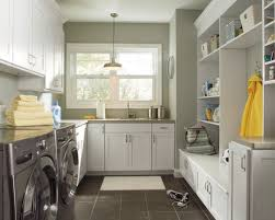 lighting for laundry room. inspiration for a transitional gray floor laundry room remodel in birmingham with white cabinets lighting