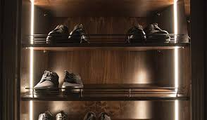 lighting for closet. vertical led strip lighting for illuminating areas along edges of closet or pantry system