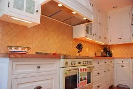 classic kitchen with battery operated under cabinet lighting classic brown stained wooden kitchen cabinet