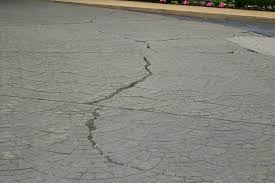 stamped concrete vs pavers vs natural