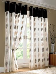 white fabric curtains with black and cream curving pattern also dark brown dr for double glass