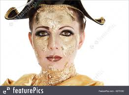 body art and beauty young woman face with gold make up mask isolated on