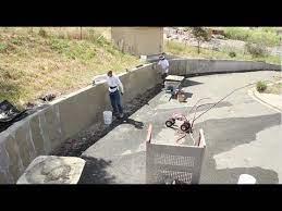 to stucco over concrete retaining walls