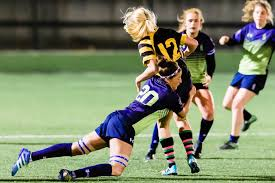 rachel carragher goes in for the tackle
