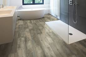 where hardwood is not recommended for installation in bathrooms and laundry rooms luxury vinyl flooring is waterproof so it makes a great and great
