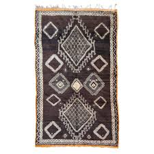 rare dark brown north african vintage berber rug with 22 diamonds design for