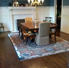 area rug under dining table what size rug to use for your dining room do i
