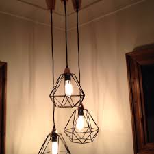love this grouping of these kmart geo pendant lights using the outdoor rope love vintage look