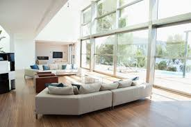 types of living room furniture. walnut floor with a simple and plain sofa accented few blue pillows nothing types of living room furniture