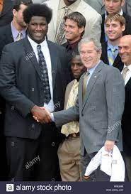 U.S. President George W. Bush (R) greets Louisiana State University Tigers  offensive lineman Herman Johnson (L) and wide receiver Trindon Holliday (C)  at a ceremony welcoming the 2007 BCS National Champions LSU