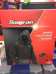 snap on heated jacket. image may contain: one or more people snap on heated jacket