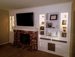 built in entertainment center with fireplace. Large White Entertainment Center Above Brick Fireplace Built In High Bookshelves With Inner Lights And Decors Cool Centers For Flat B