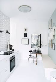 kitchen with black white and blue white tiles and black wall light bench and anatomy eat kitchen