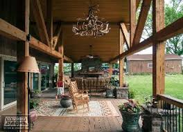 covered patio deck designs. Gable Roof Covered Cedar Deck With Stone Fireplace And Columns Lighting Chandelier In Basehor Patio Designs