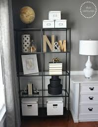 mixing metals on the bookcases ie golds silvers blacks and whites black and white bedroom furniture