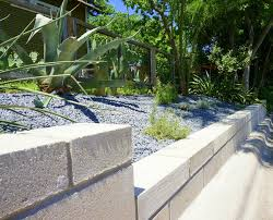 the retaining wall dips down to a lower level a diy cinder block retaining wall project