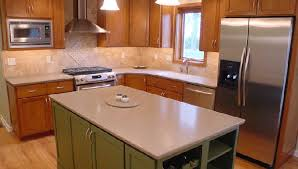 cherry with custom color painted island and corian countertops